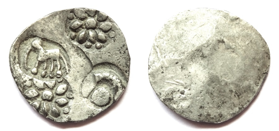 Chedi coin with an elephant standing left, symbol of sun within crescent, and flower symbol (twice); c. 400-350 BC