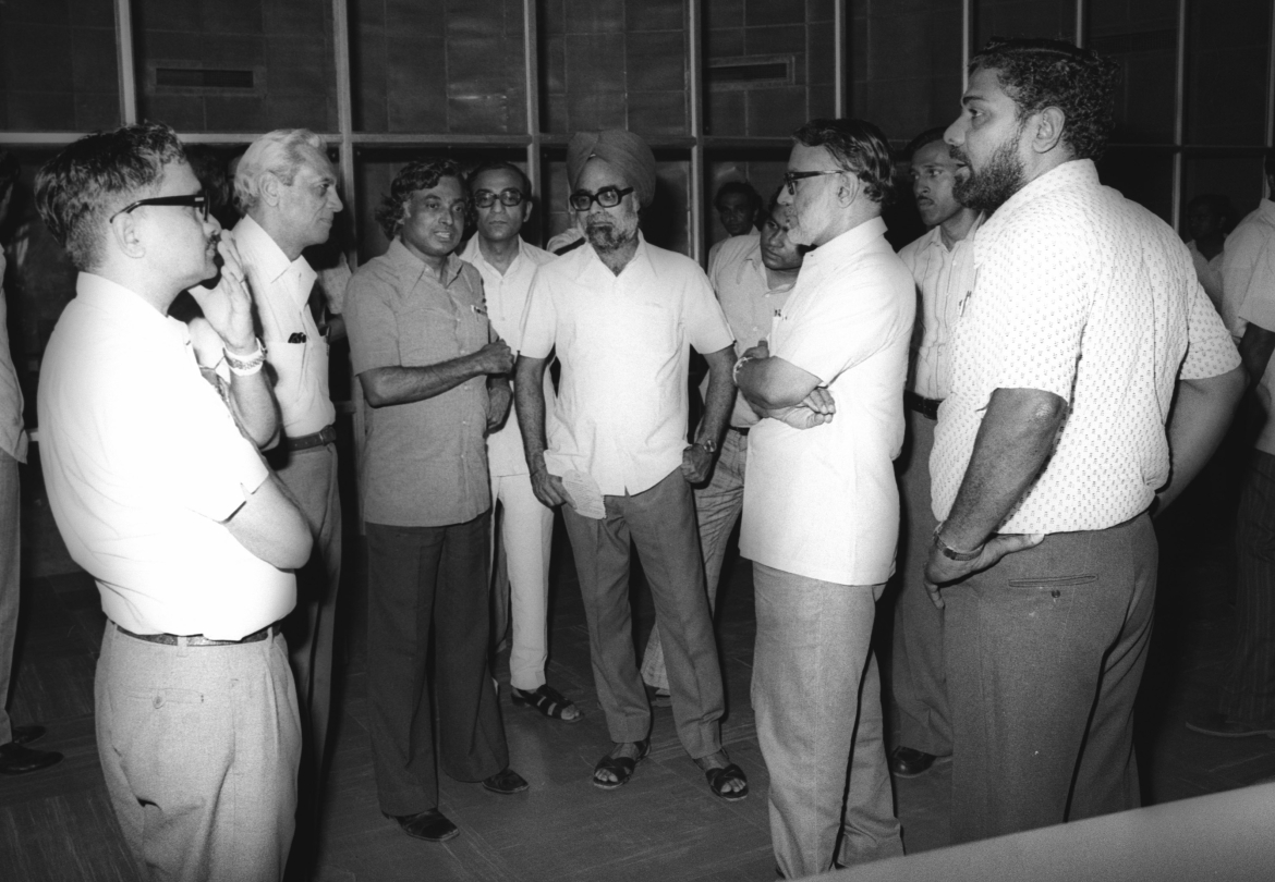 APJ Abdul Kalam briefing the Space Commission members in SHAR (8 August 1978). From left: Col N Pant, Satish Dhawan, Kalam, (not identified), Manmohan Singh, (partially seen, not identified), MGK Menon, K Narayana and R Jayamani. It is interesting to note that later, Kalam became the President of India and Manmohan Singh, the Prime Minister