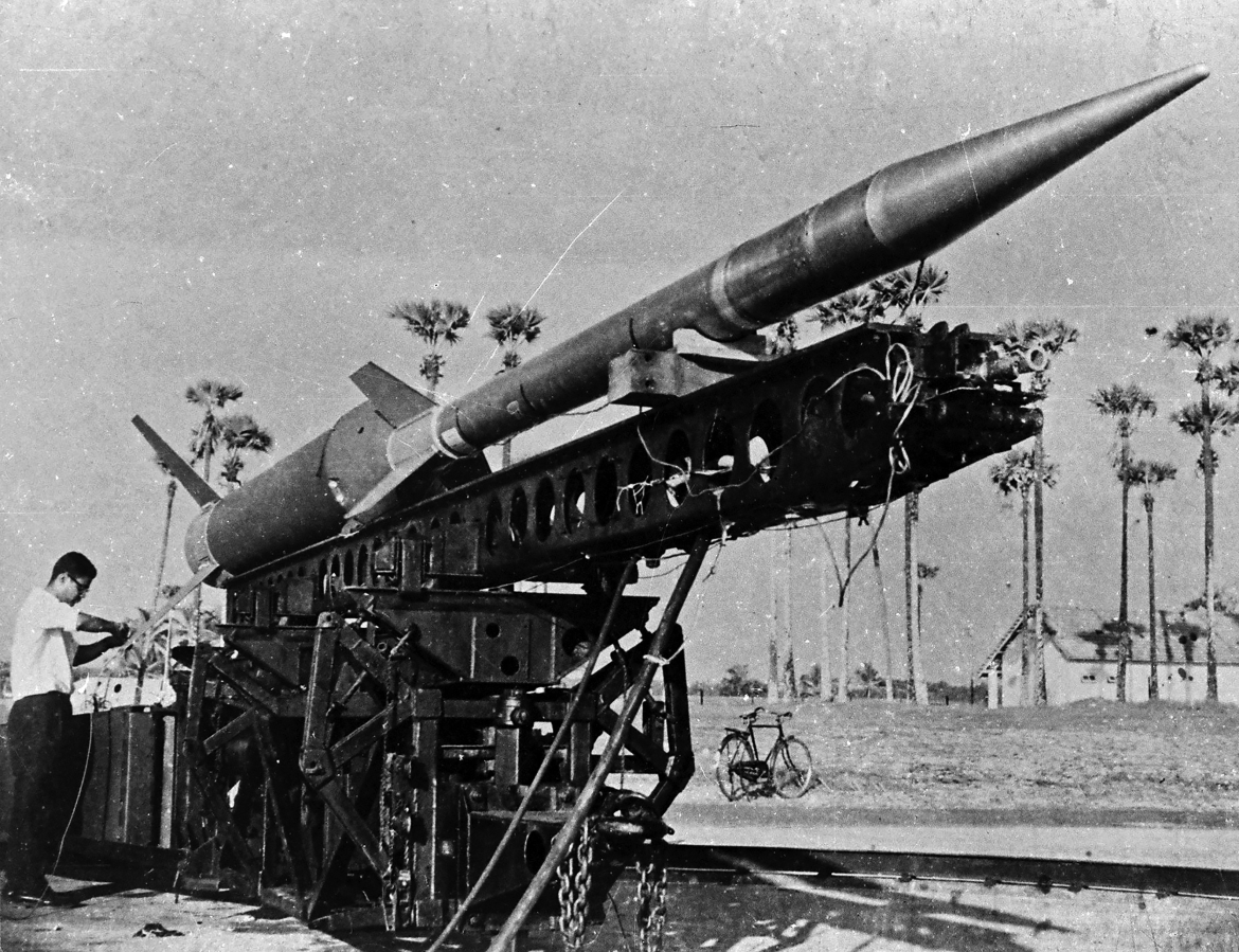 NASA also supplied Nike-Apache sounding rockets (including the one for the inaugural flight) and some tracking equipment. Nike is the name of the booster (or the first stage) while Apache is the name of the second stage. The picture shows an assembled Nike-Apache at Thumba. Note the bicycle in the background; it was the only readily available mode of transport in TERLS in the 1960s