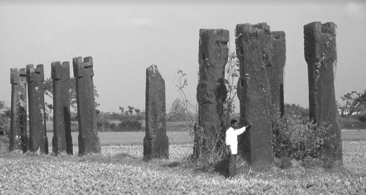 Monolithic pillars of laterite stone at centre of the site in Sisupalgarh