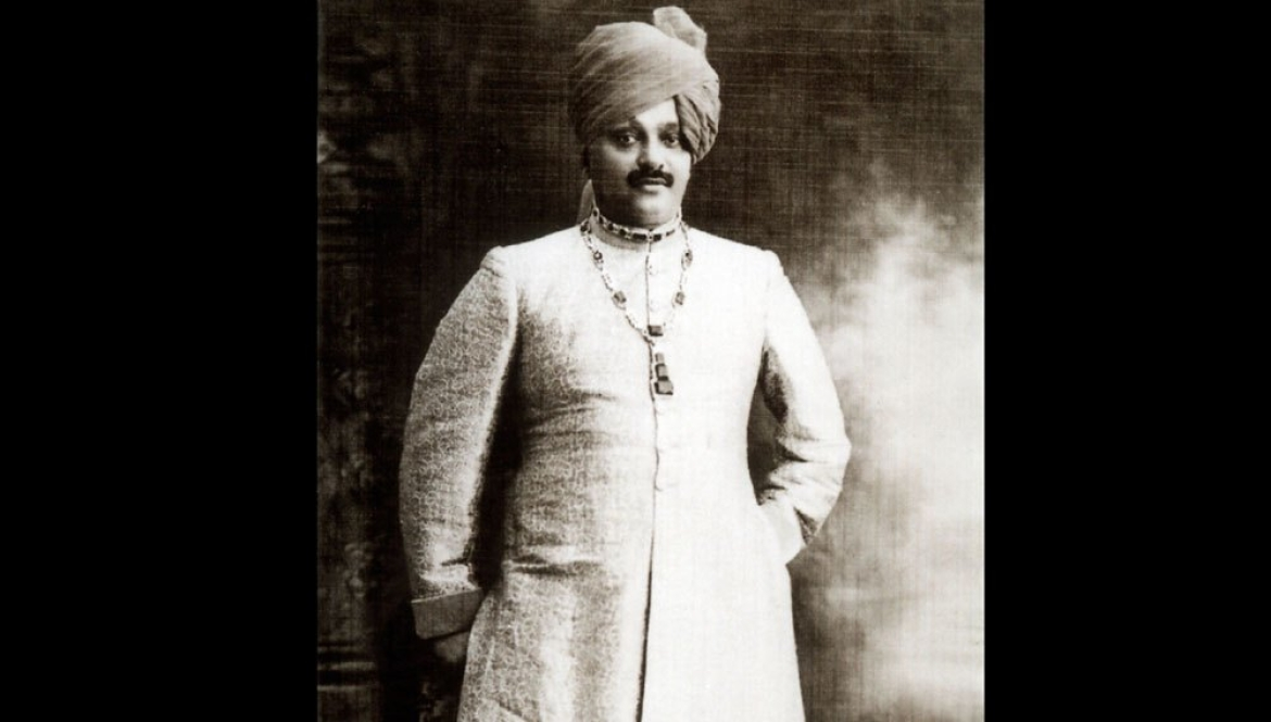 The Maharaja of Nawanagar wearing a typically lavish 1926 Cartier necklace with emeralds and diamonds