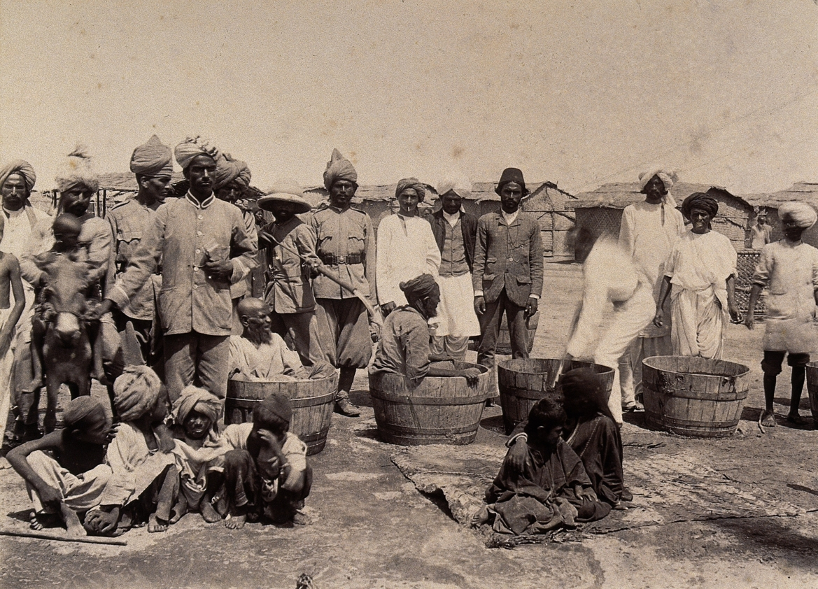 Disinfecting sufferers of the plague in wooden tubs, Karachi