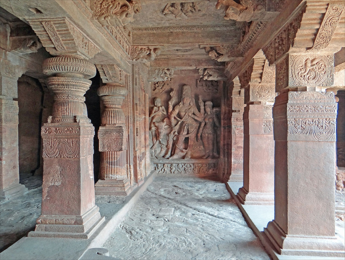 Shiva sculpture and engraved pillars in Cave 1