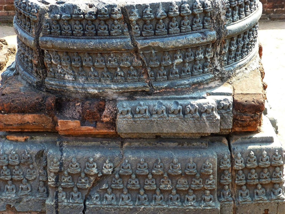 Detailing on a votive stupa, it shows Buddhas in different Mudras