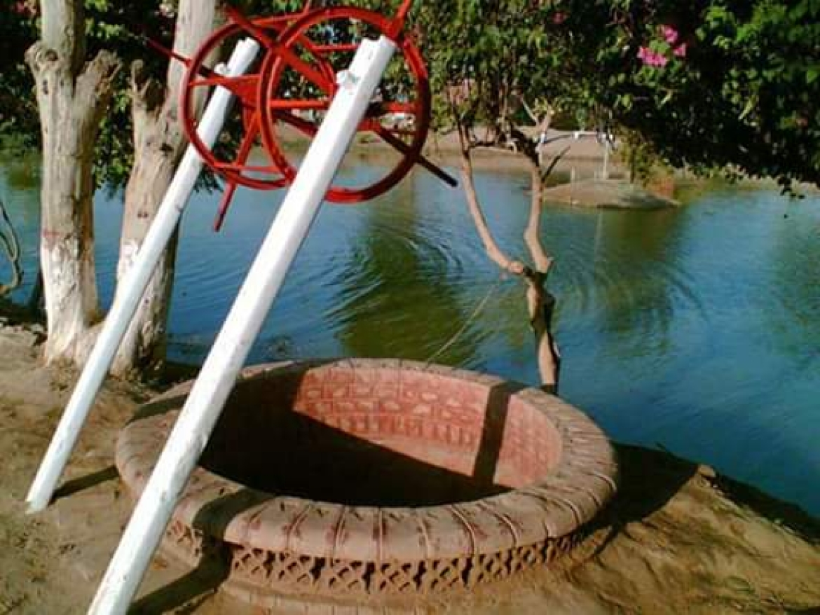 One of the two wells in Teku Park
