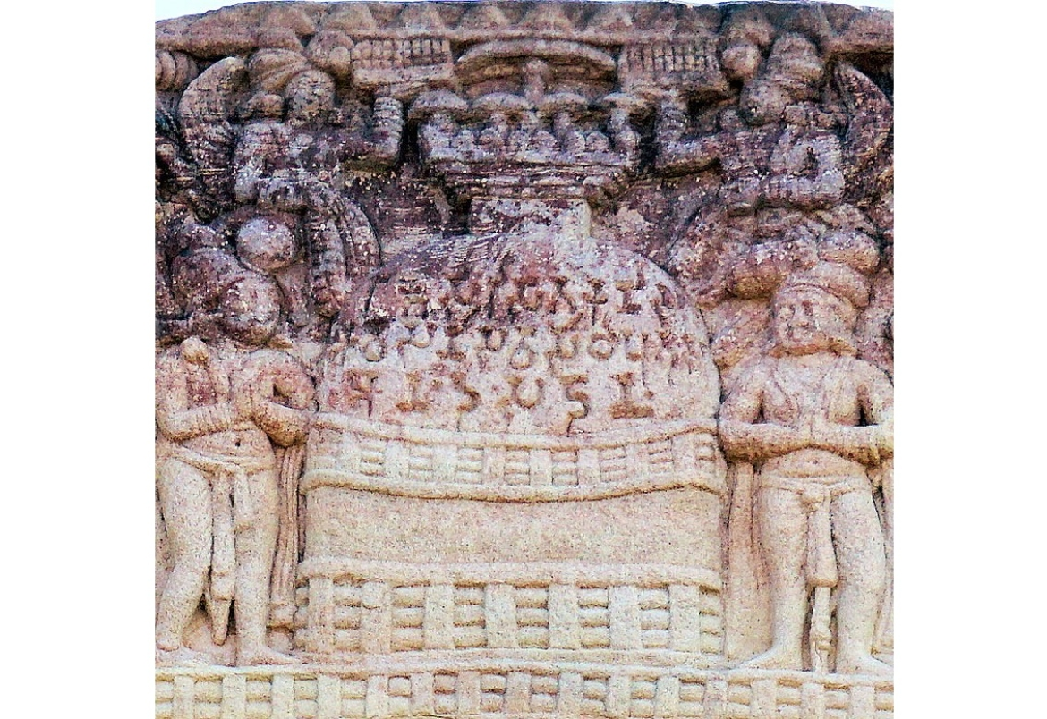 The Sanchi stupa inscription is written in three lines in early Brahmi script over the dome of the stupa in this relief.Dated circa 50 BCE- 0 CE.