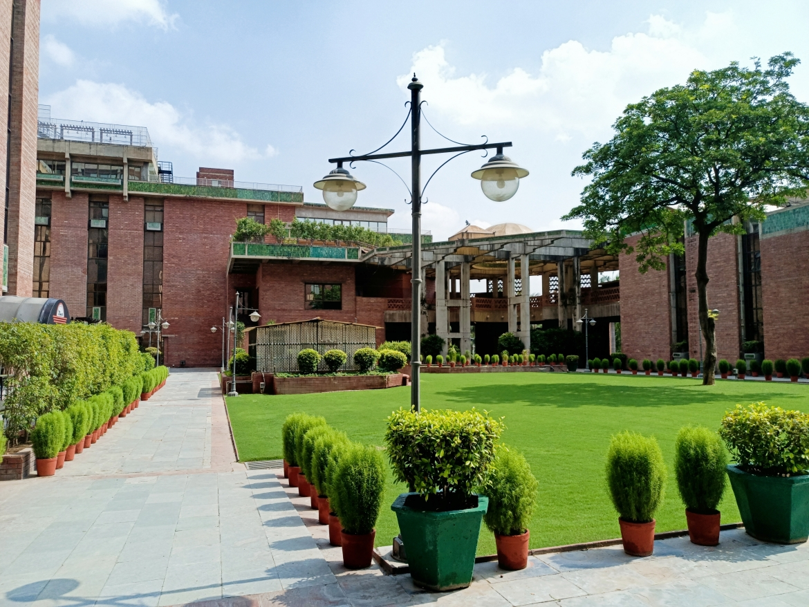 Wide green courtyards surrounded by offices, India Habitat Centre