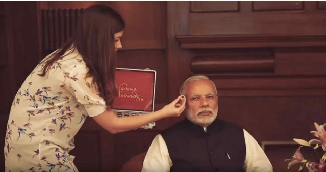 "The alleged ""makeup artist"" is actually holding up an eyeball for a study of Modi's face for a Madame Tussauds museum statue.(Photo: Madame Tussauds)"