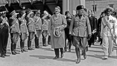 "Adolf Hitler and <a href=""http://encyclopedia.thefreedictionary.com/Benito+Mussolini"">Benito Mussolini</a> during Hitler's visit to <a href=""http://encyclopedia.thefreedictionary.com/Venice"">Venice</a> in June, 1934; <i>Wikimedia Commons</i>"
