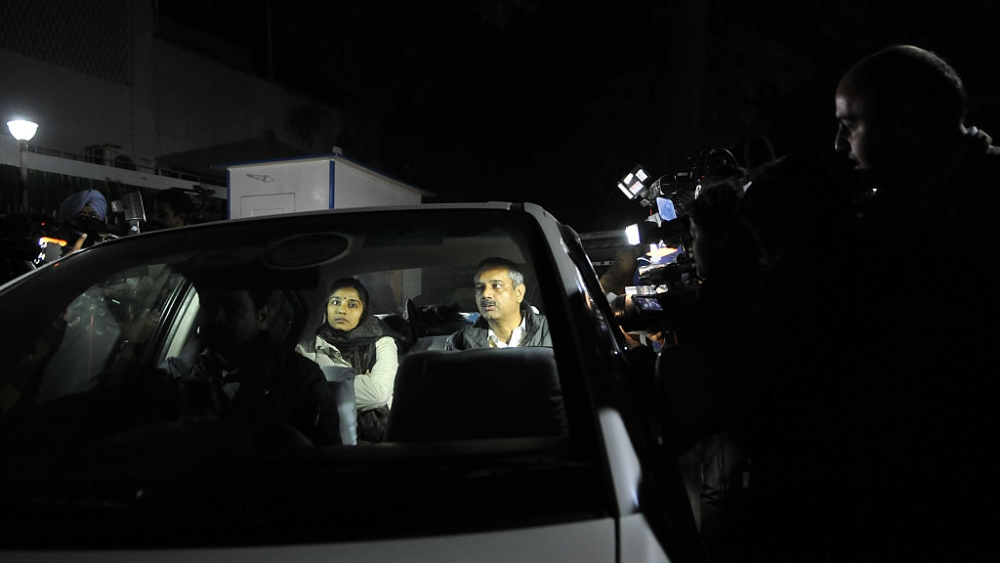 File photo of former Delhi Principal Secretary Rajendra Kumar and his wife being taken for questioning by CBI after the raid at his Delhi residence in December, 2015
