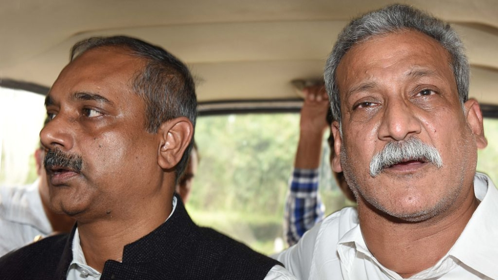 File photo of former Delhi Principal Secretary, IAS officer Rajendra Kumar (left) being produced at Patiala House Court in a case of alleged corruption in July, 2016