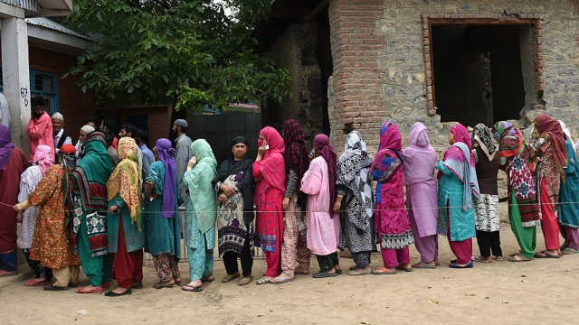 Representational image. File photo of voters outside a polling booth in Anantnag assembly seat on June 22, 2016