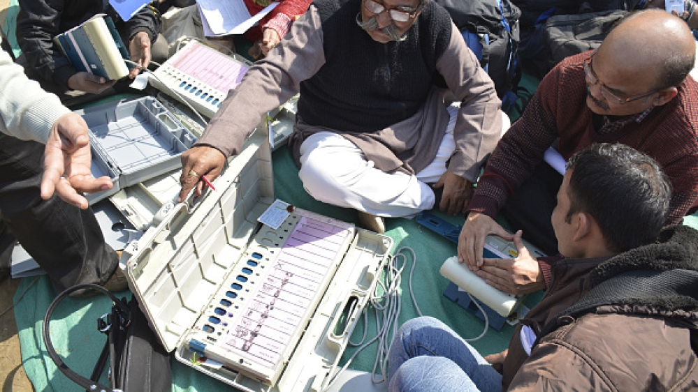 A file picture of polling officials with electronic voting machines (EVMs) on the eve of Uttar Pradesh assembly elections in February this year