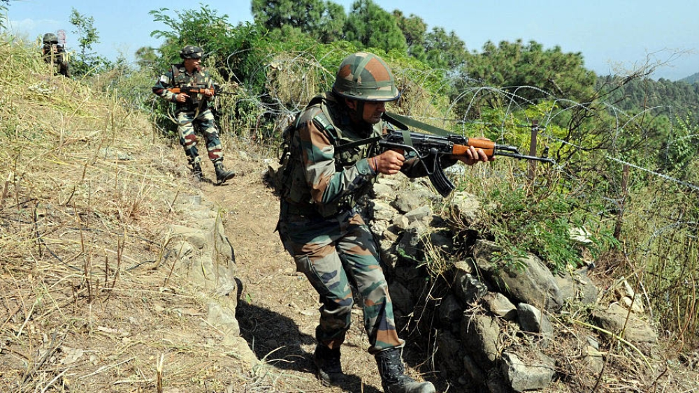 File photo of Indian army soldiers taking position near the Line of Control bout 145 km from Jammu, India