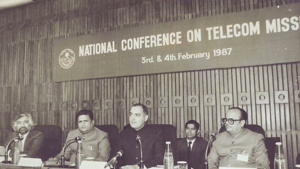 A file photo of  the late former Indian Prime Minister Rajiv Gandhi (second from right), telecom inventor Sam Pitroda (left) and others at a conference