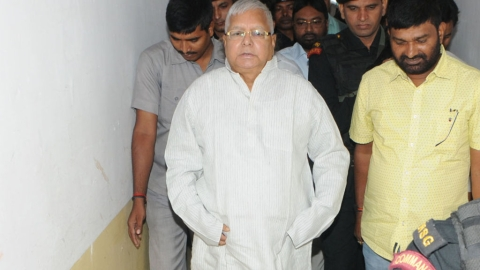 'Ex-Railway Minister' Lalu Prasad booked for 2006 deal