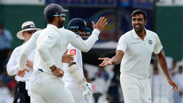 R Ashwin celebrates with the team after picking up a wicket on day two