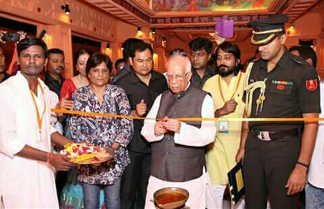 Rashmi Gandhi, also named by Santosh as a key member of his team, with West Bengal Governor Keshari Nath Tripathi.