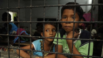 Children sitting beside a window after the Bashirhat communal violence on July 5