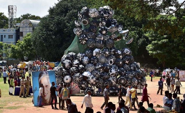 A poster of slain journalist-activist Gauri Lankesh put up next to a mountain of umbrellas at a rally to speak against her assassination at Central College ground in Bengaluru.