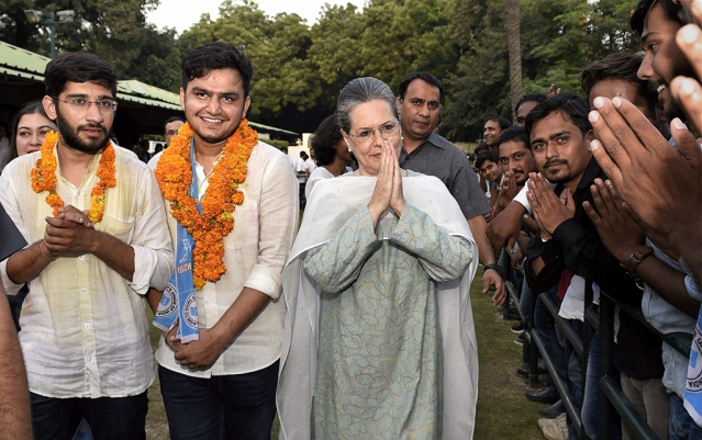 New Delhi: Congress president Sonia Gandhi with NSUI's winning candidates Rocky Tusseed (President) and Kunal Sehrawat (Vice President) meet students after winning the DUSU 2017 elections in New Delhi on Wednesday.