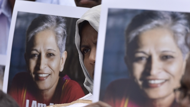People stage a protest against the killing of senior journalist Gauri Lankesh, at Town Hall on September 6 in Bengaluru