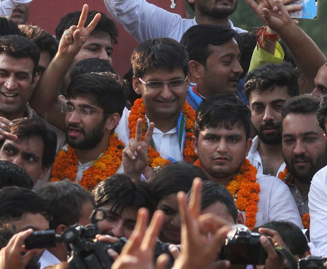 NSUI's Rocky Tusseed and Kunal Sehrawat with Congress Lok Sabha MP Deepender Singh Hooda flash victory signs after winning the president and vice-president's posts in DUSU 2017 elections.