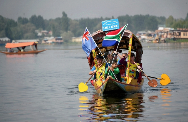 Participants take part in the shikara race during the Expedition India Adventure at Dal Lake in Srinagar.