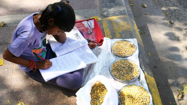 On in international child day Bhumika preparing for her first  semester and help her mother to sell milittes at conaught place in New delhi