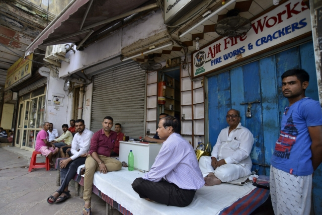 Firecracker traders sit idle outside their shops near a Jama Masjid market in Delhi on Oct 9, 2017. The Supreme Court on 9th October ruled that there will be no sale of firecrackers during Diwali, as it restored a November 2016 order banning the sale and stocking of firecrackers in Delhi and National Capital Region