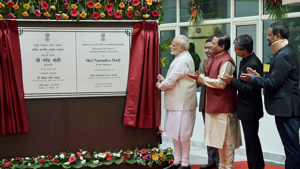 Prime Minister Narendra Modi unveils a plaque to 'dedicate' All India Institute of Ayurveda to the nation.
