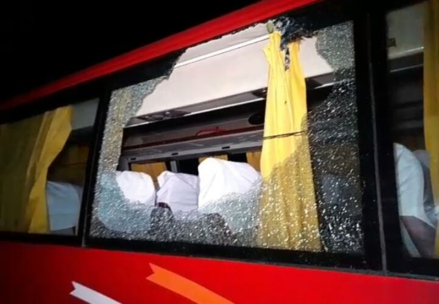 A view of a damaged window of the bus which was carrying Australian cricket squad after a stone was thrown at their bus on its return to a city hotel from the Barsapara Cricket Stadium in Guwahati