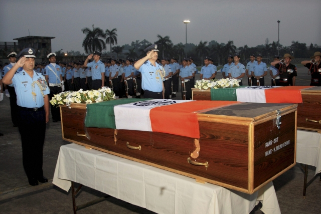 IAF officers pay homage to  two Air Force commandos, Sgt Milind Kishor Khairnar and Corporal Nilesh Kumar Nayan, who died  in an encounter in J&K's Bandipora district.