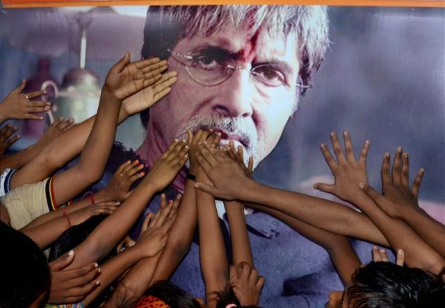 Children greeting actor Amitabh Bachchan on his 75th birthday through his poster in Kolkata