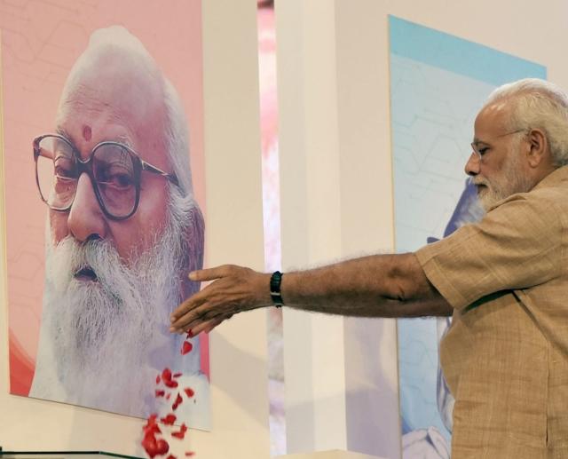 Prime Minister Narendra Modi pays floral tributes to political leader Loknayak Jaiprakash Narayan and Sangh Parivar veteran Nanaji Deshmukh on his birth centenary celebrations at Indian Agricultural Research Institute (IARI) on Oct 11, 2017. Also seen Union Rural Development, Panchayati Raj and Mines Minister Narendra Singh Tomar.