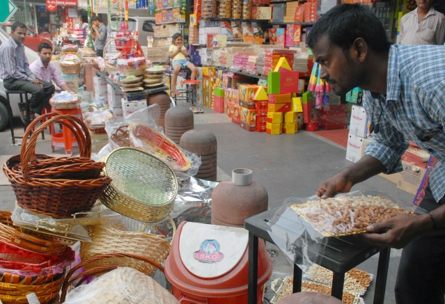 Dry fruits are being packed for Diwali  at Bengali market in New Delhi.