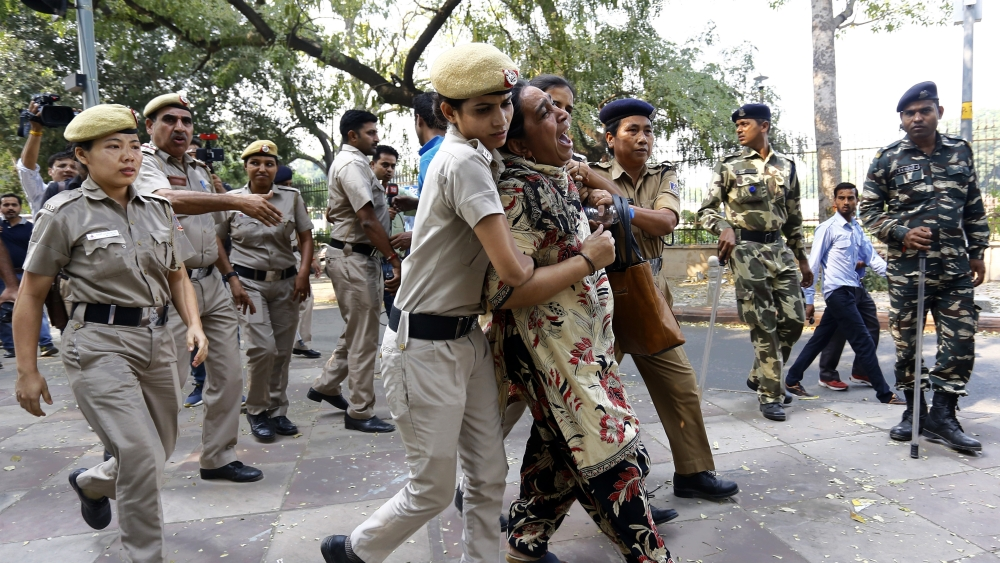 Fatima Nafees being dragged away from the High Court premises by the Delhi Police