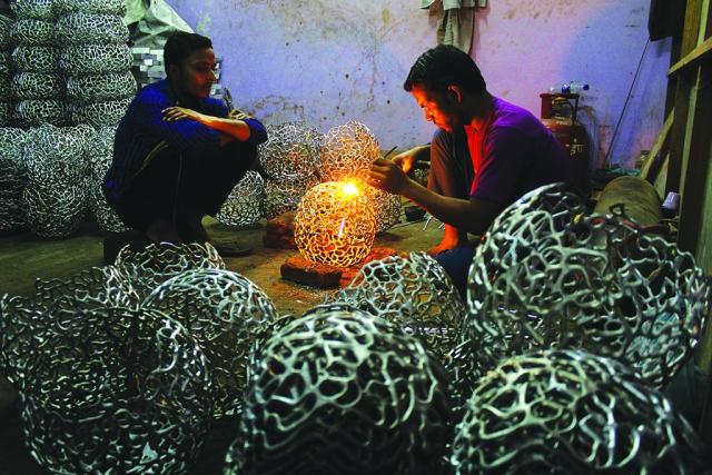 Moradabad: Craftsmen weld artifacts at a metal workshop
