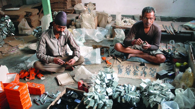 Aligarh: Workers at a lock-making unit