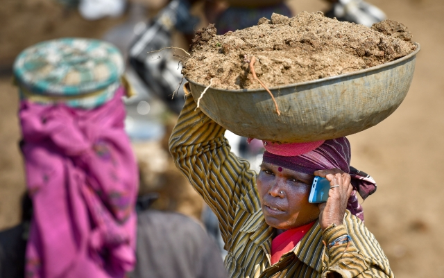A file photo of a woman working under the MNREGA scheme in Karnataka