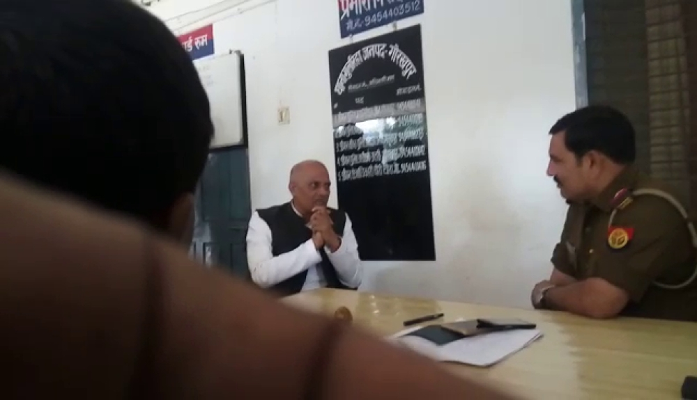Mahendra Pal Singh, BJP MLA from Pipraich in Gorakhpur district, sits in Guleria Police Station with folded hands.