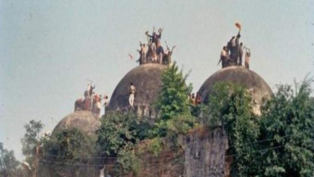 Karsevaks climb atop Babri Masjid on Dec 6, 1992 (file photo)