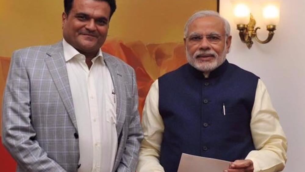 File photo of Mukesh Patel with PM Narendra Modi