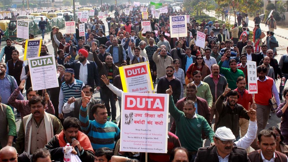 Delhi University Teacher's Association protests against an alleged recruitment scam, outside the University Grants Commission on Bahadur Shah Zafar Marg in Delhi on Thursday, February 8