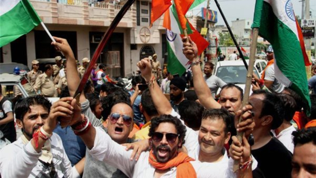 Activists of  Bajrang Dal brandish swords and tricolour during a procession in Jammu in August last year (file photo)