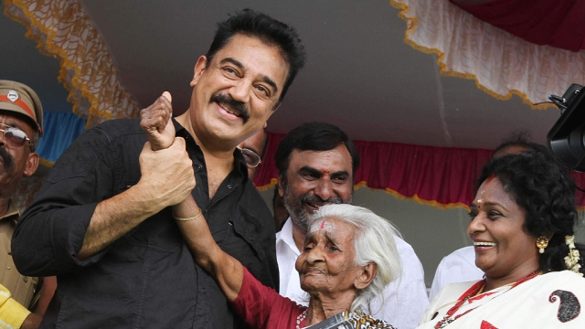 File photo of actor Kamal Hassan (left) along with volunteers during the cleaning of Medambakkam lake in Chennai