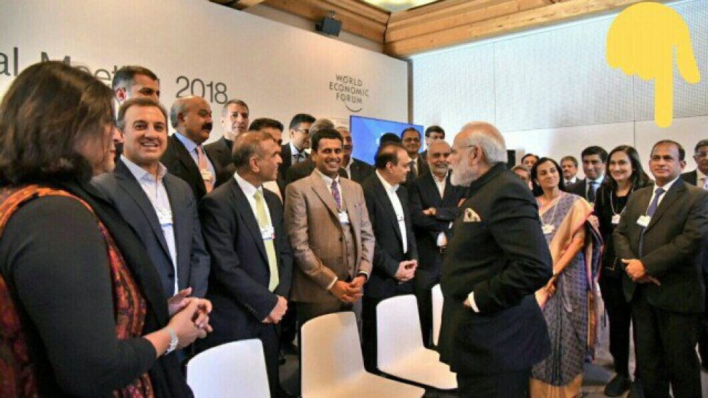 File photo of PM Narendra Modi interacting with Indian business leaders in Davos; Nirav Modi is seen standing behind the PM