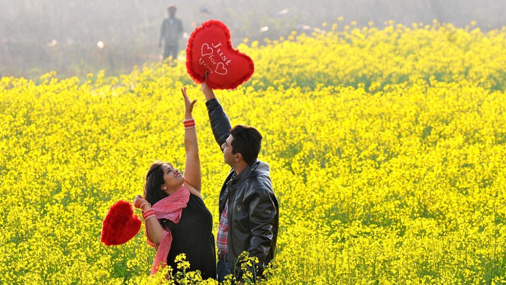 File photo of a young couple sharing a light moment on Valentine's Day, February 14
