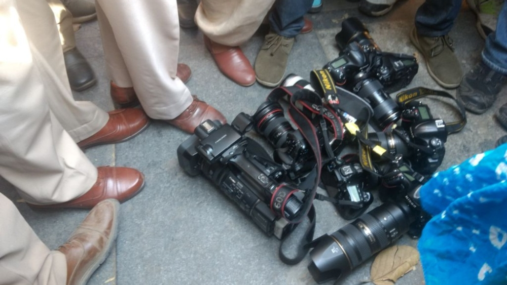 Cameramen put their cameras at police's feet as a mark of protest