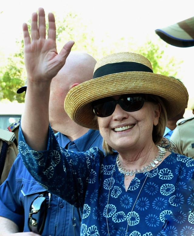 Former US Secretary of State Hillary Clinton waves as she arrives at Jodhpur Airport, in Jodhpur.